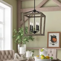 This chandelier in the weathered oak wood and antique forged iron artisanal finish offers rustic flair in an iconic lantern silhouette. Something about the vintage, weathered look alludes to simpler times, but the crisp edges and bold lines with open frames bring us back to a more modern style. This neutral ambient light fixture provides comfort with elegance to your dining room, kitchen or hallway.