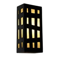 The Grid Wall Sconce features a rectangular box lantern design with colored panes of glass framed by asymmetrical grid lines on three sides. Light shines through openings at the top, the bottom and creates a warm glow through the glass. Handmade to World Menagerie's exacting standards, using a kiln-fired ceramic base and recycled window glass from local sources.