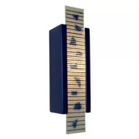 Our Zen Garden sconce has a rectangular ceramic base which frames a glass pane of alternating horizontal stripes of color interspersed with beautifully raised pieces of fused colored glass. Light shines through openings at the top, the bottom and naturally illuminates the design of the glass. Handmade to World Menagerie's exacting standards, using a kiln-fired ceramic base and recycled window glass from local sources.