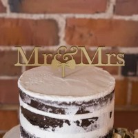 Love doesn't get much cuter than this Mr. & Mrs. Bow Tie Cake Topper product. It features Mr and Mrs text with an adorable bow tie for the finishing touch. Completely food-safe, simply insert into the top tier of your cake for a unique and sweet addition.