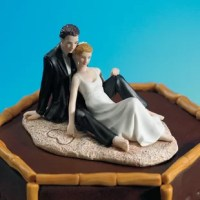 Complement your romantic beach setting with this beautiful Couple Lounging on the Beach Cake Topper product. Exquisitely detailed down to the heart drawn in the sand with her delicate finger.
