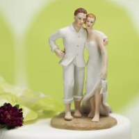 A romantic walk on a beach, a casual backyard wedding. This Bride and Groom Beach Cake Topper product is a simple, fresh approach to the traditional wedding couple.