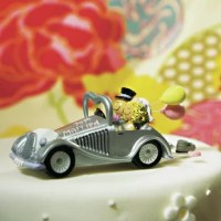 Whimsical and fun, this Get-a-way Car Cake Topper is an adorable product that's sure to inspire a smile. Whether displayed atop your cake or given as a novelty gift, this comical bride and groom will set a very happy tone.