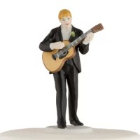 This Guitar Playing Groom Cake Topper handsome groom is in the mood for romance music. Guitar in hand, he will serenade any of mix and match brides to personalize the look. Hand-painted porcelain.