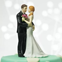 This Cheeky Couple Cake Topper product shows that two can play the game. Obscured from the front view, both seize the opportunity to exchange a little