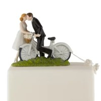 This Bicycle Bride and Groom Cake Topper product are ready to pedal their way down the road to romance. The old fashioned bicycle and basket, and the Bride's knee-length dress add just the right amount of vintage flair to this product.