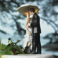 A beautiful dress, a stylish suit, one white umbrella and a great pair of rubber boots all combine to create this very adorable Love Couple Cake Topper. Some believe that rain on a wedding day will bring good luck. Regardless, rain or shine, this product is sure to stand out for all the right reasons.