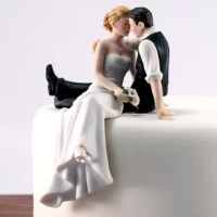 Caught sneaking a kiss, this Love Bride And Groom Cake Topper product takes a moment for romance. Place the groom atop a layer of the wedding cake and let him embrace his Bride and she dangles her legs over the edge.