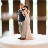 Celebrate the sweetness of your love with this Bride Embracing Groom Cake Topper product. Featuring a vest sporting groom and a daintily clad bride, this couple captures the softness of love perfectly.