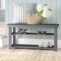 If you find yourself stepping on your shoes as opposed to into them, it might be time for a storage solution. This bench does it in fine style, offering the clean-lined silhouette associated with modern aesthetics and sporting a planked top for a touch of easygoing, breezy flair. Crafted from a mix of solid and manufactured wood, this design features two shelves down below for stashing your feet's faves and more, while the bench itself offers a space for guests to take a seat.