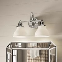 The bathroom remodels to come in many forms, but across all of them, one thing remains the same: lighting matters. Layers of lighting turn tiny washrooms into statement-makers and large-scale bathrooms into spa sanctuaries. Take this two-light vanity luminary for example: defined by the two-pronged arm, and bell shades – it's perfectly at home in modern and contemporary aesthetics. Crafted of metal and milk glass, this fixture accommodates two lightbulbs of up to 100 W (bulbs not included).