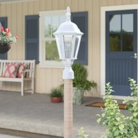 Beyond lending a stylish focal point to your front walkway, outdoor wall lanterns welcome guests to the front door, increase safety during dark nights, and lend a little curb appeal to your abode. Take this piece for example: Crafted from die cast aluminum, it strikes a traditional silhouette and features an eye-catching finial up top. Its angled glass shade diffuses light in all directions and accommodates one 100 W E26 LED or incandescent lightbulb inside (not included).