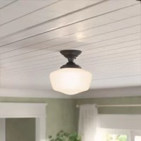 Designed to attach to the ceiling with little to no gap between the fixture and the ceiling, semi flush mounts are perfect picks for spaces on the smaller side. This luminary showcases the vintage charm, too, with a clean-lined silhouette modeled after schoolhouse lights. Crafted from steel, it features a frosted glass shade that diffuses the glow of a single bulb (not included) throughout your space. Plus, it's compatible with dimmer switches, so you can set the mood of your ensemble in a snap.