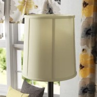 An essential part of any lamp, shades lend an extra dash of style as they soften the glow of bulbs. This drum-shaped design is crafted from a silk fabric that offers a subtle touch of texture, while its eggshell white hue blends with a variety of color schemes. An inside spider attachment and included fitter make it easy to place this piece onto the lamp of your choice. Measures 18'' W x 18'' D x 19'' H.