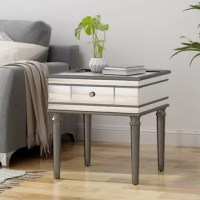 Sleek and fabulous, this End Table with Storage is the perfect way to complete your living room or bedroom collection. Thick, mirrored tempered glass adorns a strong frame of faux wood. A central built-in drawer offers you a place to stow away odds and ends. Embellished edges and turned firwood legs and accents come together in a look that is both glam and modern.