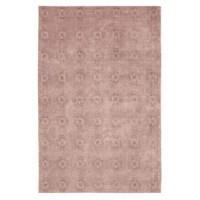 This Jacquard Blush Area Rug brings timeless style and spirited design to your home décor.