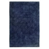 This Jacquard Navy Area Rug brings timeless style and spirited design to your home décor.