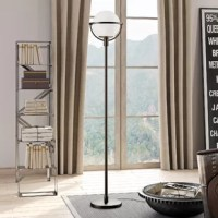 This globe and stem style floor lamp adds an airy feel to any room. The glass sphere diffuses light gently into your space, creating an elevated style. The  base finish complements the sleek orb shade with a clean, glamorous and contemporary look. Refresh any room with this modern yet consumable floor lamp.