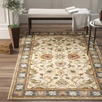 Welcome classic character and floral flair into any arrangement with this dynamic area rug, showcasing a traditional Persian-inspired pattern with botanical accents. This piece has a low 0.393