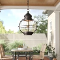 Your outdoor lighting is an important touch for rounding out your home: not only does it make your space more safe by brightening up the night, but it also sets the tone for your home decor from your front door. Take this hanging pendant, for example: taking cues from lanterns of yesteryear, this piece showcases clear seeded glass set within a bronze-finished metal frame for a traditional look wherever it hangs. This luminary accommodates two 40 W bulbs, although none are included. Designed to...