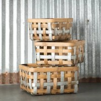 Everything looks better in a basket! This Bushel 3 Piece Bamboo Basket Set, handcrafted of natural materials, brings an organic element to your space. Nesting as a trio of utilitarian marvels, you can easily stow items in an organized manner that looks fabulous all the while.