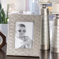 Display those cherished memories with a touch of silver elegance. This photo frame accentuates any space with its rich brushed silver hue and beautiful pattern that turns every picture into a conversation starter. You'll love the glass front that protects your valued pictures, the heavy resin that exudes an expensive feel and the easel back that makes displaying your photos an effortless affair. Whether you're looking for the perfect treat for gammy or pop-pop, mom or dad, colleague or...