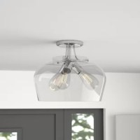 When it comes to good lighting, your fixture can make it or break it. Find the light you love with this semi-flush mount. Crafted from metal, this piece features a circular base and curving arms, working well in different kinds of settings. A glass bowl shade diffuses light from any three medium-base bulbs up to 60 W (not included), use stylized bulbs like nostalgia or tubular for a different look!