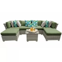 Create a space to sit back and soak up some sun beside loved ones with this seven-piece sectional set, complete with two armless chairs, one left armchair, one right armchair, one end table, and two ottomans. Crafted with an aluminum frame, each UV-resistant piece is wrapped in resin wicker in a vanilla creme tone with woven details for a breezy and airy look. Foam-filled cushions with removable covers top each seat to provide 6