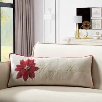 This gorgeous Happy Holiday Poinsettia Indoor/Outdoor Lumbar Pillow is embellished with distinguished poinsettia and metallic gold embroidery, a spirit of holly for Christmas decoration.