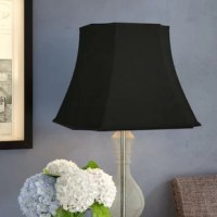 This rectangle inverted cut corners bell lamp shade is a part of their basic shade collection and is perfect for anyone who is looking for a traditional, yet stunning lamp shade. Please measure your existing shade a replacement harp may be needed for a proper fit if changing the height of your shade. Their multiple shade lines exemplify handcrafted quality and value.