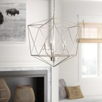 Providing a minimalist, modern style that seamlessly blends with almost any interior, this chandelier is sure to shine in the entryway or over the dining room table. Crafted from metal, it strikes a geometric silhouette that encases a trio of candle-style sockets, each of which accommodates a 60 W maximum bulb (not included) to cast a warm, welcoming glow throughout your space. Plus, this design is compatible with sloped ceilings, so you can truly customize your look.