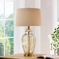 Golden 29'' Table Lamp makes an elegant addition to your living space. This unique lamp features a luxuriously designed glass base with a beautiful shade to give your home that stylish and elegant accent. Display it on a side table and its fine details will accentuate and complement your home decor.