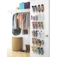 Organize your shoes in this Over the Door Shoe Bag. This shoe organizer has a simple design that blends with many decors. It has a robust structure, which makes it suit most homes conveniently.  Made from polypropylene and see-through vinyl, this organizer is sturdy and durable. Finished in white, this shoe organizer looks great with any decor and color schemes. This over the door organizer helps to keep your room clutter-free. You can conveniently arrange the shoes and keep them in place....