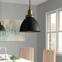 Fusing function and factory flair, this one-light bell pendant illuminates any arrangement in style. Crafted from metal, this fixture features a round canopy, an adjustable hanging wire, and a dome-shaped shade. A two-toned finish outfits this design to create crisp contrast, while still ensuring it's neutral enough to complement most color palettes.