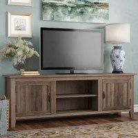 Rustic and modern elements meet in this clean-lined TV stand, sized to accommodate flat-screens up to 70