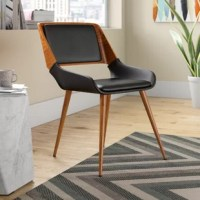 If your dining chairs aren't satisfying your craving for style and function, then it might be time to serve up smarter seating. And if you're looking to dine with a modern flair, then an option like this could be just the thing you need. Founded on four tapered circular legs, this chair features a clean-lined silhouette for just the touch of mid-century modernism in the dining room. Featuring a gently curved back, along with an upholstered, padded seat, it's wonderful for relaxing into for...