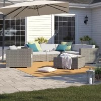 Welcome backyard BBQs, pool parties, and happy hours all summer long with this must-have seven-piece sectional seating group. Including an arm chair, coffee table, and five-piece sectional, it offers everything you need to entertain out on the patio or deck. Designed to live outdoors, this set is crafted from weather-resistant materials (namely aluminum, resin wicker) so there's no worries when it comes to UV light beaming down and rainstorms rolling through.