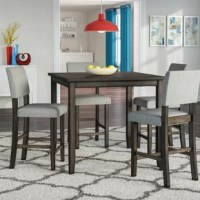 A foodie feast doesn't have to happen at a restaurant! Invite a few friends over for the evening to give them a culinary experience they won't soon forget; or at least your best attempt at chips and guac. Anchor it all with this understated five-piece dining set. Featuring a bar height design, this ensemble offers a clean-lined manufactured wood table finished in a grayish-brown hue, while four included side chairs upholstered in gray fabric can be grouped around it.