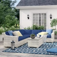 Create a space to sit back and soak up some sun beside loved ones with this seven-piece seating group set, complete with one corner chair, three armless chairs, one left armchair, one right armchair, and one rectangular coffee table with a hidden storage compartment underneath. Crafted with an aluminum frame, each UV-resistant piece is wrapped in resin wicker in a vanilla creme tone with woven details for a breezy and airy look. Foam-filled cushions with removable covers top each seat to...
