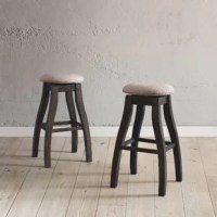 Spin yourself right around with this backless swivel bar stool. Crafted from solid wood, this swivel barstool comes upholstered in 100% polyester material with a foam-fill that cushions your seat. Its natural wood grain hue gives it a rustic, cottage aesthetic, while the curved wooden legs add a charming dose of character. The swivel design ensures you never miss a conversation with friends and family, and the backless seating allows for complete mobility. Arriving in a set of two, these 30'' H...