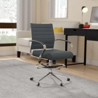 Lift the aesthetic of your home or office with a stylish and well-built drafting chair. A selection of vegan leather colors offers upholstery that brings a sophisticated touch. Enjoy ergonomic benefits with adjustable seat height and footrest height. Padded armrests round out the comfort details and make this an excellent choice.