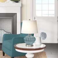 Lightweight, portable, and mindful of space, table lamps keep your home looking on the bright side with a just-right task and accent lighting. The perfect pick for any cozy coastal home, this one features a round base made from glass awash in a solid, translucent finish. Up top, the included empire shade made from fabric boasts a white finish and accommodates one 60 W E26 incandescent light bulb (not included).