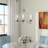 Doubling as a source of light and the focal point in any room, chandeliers are experts at fusing function with fashion. Take this one for example: suspended by a chain, this piece is crafted from metal and boasts three curved arms, lending some understated appeal to your arrangement. Three clear glass shades diffuse light from any medium-base bulbs up to 60 W (not included), ideal for brightening up your space in contemporary style.