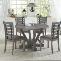 This round dining table features a sturdy trestle style base and is finished in a wonderful harbor gray color. This transitional dining table will work in many settings.
