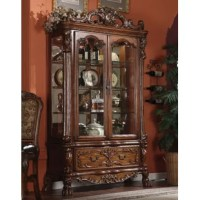 This Welliver China Cabinet reflects highly decorative details, oversized claw feet, shaped top and decorative carving inlay veneers. This collection will be the showpiece of your dining room environment.