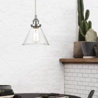 Designed for contemporary decor, this item features a conical clear glass shade with matte black and bronze embellishments. A delightful addition over a kitchen island, this pendant lends a refined sensibility while maintaining an inviting, casual allure.