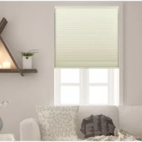 An essential for windows in the bedroom, den, and other areas of your abode. This room darkening cellular shade helps keep the sun out in style. Crafted of fabrics that help darken your ensemble, it offers a honeycomb construction with a solid hue that blends right in with most aesthetics. A cordless design makes it a little more minimal, perfect for keeping pets and small children from tampering or getting caught in a hanging cord.