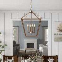 When it comes to overhead lighting, pendant lights are a fan favorite – and for good reason. They don't take up prime real estate, they offer options for up and downlighting, they work well solo and in clusters, and they come in an endless amount of styles! Take this four-light pendant, for instance: Crafted from metal, it showcases an openwork frame awash in a solid metallic finish - making it right at home in any modern farmhouse-inspired space. Inside, it accommodates four 40 W E12...