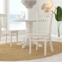 Combining the enduring appeal of the traditional aesthetic with the breeziness of the coast, this dining chair is a perfect pick for laid-back eating ensembles. Crafted from solid wood, it features a streamlined silhouette that generates visual interest with a slat-style back, a contoured seat, and a slightly curved crest rail. Plus, the included rubber caps help protect your floors from scratches and scuffs. This design arrives in a set of two.
