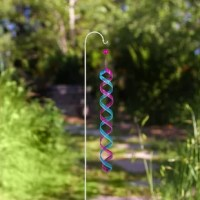 Add a touch of ambiance to your patio, lawn, or garden with wind rotator. This durable, colorful spinner is made of iron to withstand the harshest wind conditions and last throughout all seasons. The blue and purple colors are stylish all year long and look great with any outdoor decor. The colors blend together as the wind swirls the double helix to create a beautiful color collage. The spinner is the perfect portable decor for lining your driveway, walkways or planting beds to be easily seen...